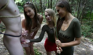 3 young girls walking in the woods find a restrained man and suck his cock