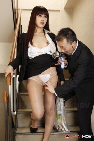 Japanese chick Haruna Sendo has her hairy pussy exposed by man with a vibrator