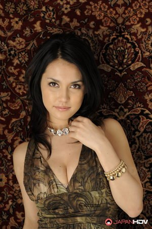 Japanese beauty Maria Ozawa models non nude in a dress and jewelry