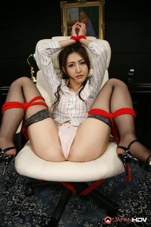 Clothed Japanese woman is tied up with her panties on display
