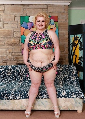 SSBBW model Velma Voodoo draws attention to her shaved pussy in heels