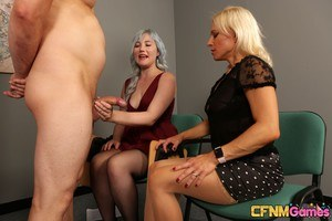 Clothed females compete to see which of them is the best sucker of hard cocks