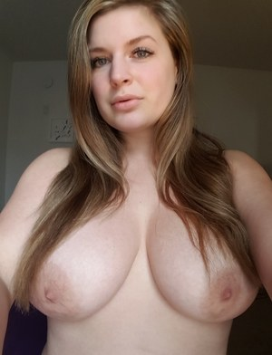 Big titted amateur takes nude and semi-nude selfies around her house