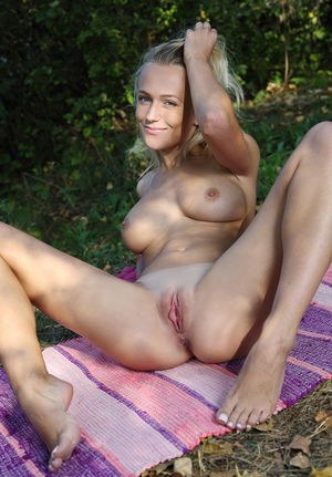 Thin blonde Vika P models naked on towel after removing her bikini in woods
