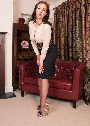 Sexy in the drawing room is Tindra. In this cute looking scene she ends up very kinky indeed with her stripped down to vintage sheer nylons and satin leopard extreme sky high stiletto heels. See her plump juicy pussy spread wide!