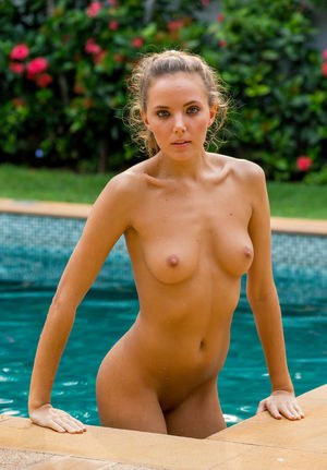 Flexible slut Clover stretches legs to show wet bald pussy by the pool