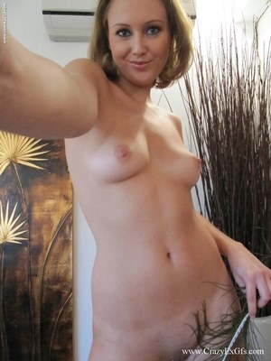 Amateur blonde takes self shots of her tan lined breasts as she gets undressed