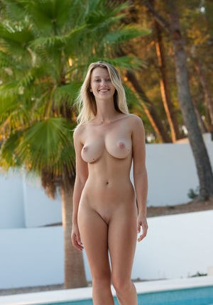 Busty Carisha loves posing nude at the pool showing off her killer curves