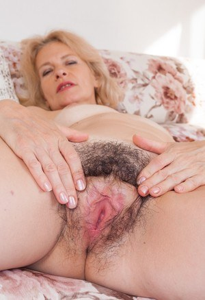 Mature lady Diana Douglas parts her hairy bush in her nude modeling debut