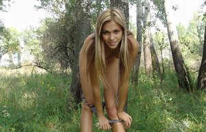 Young blonde girl makes her nude modeling debut in the forest