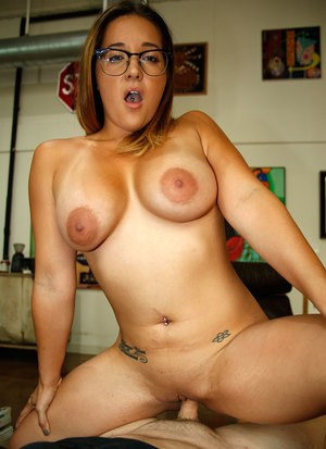 Big titted chick Jean Michaels jerks off a cock with her glasses on