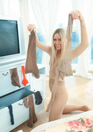 Kinky young blonde Jenny dons sheer pantyhose over her head  clothing
