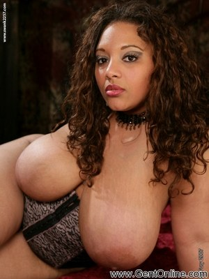 Latina BBW Lady Spice rocks her huge boobs while toying her snatch