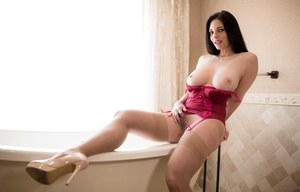 Solo model with black hair free her nice melons from satin lingerie