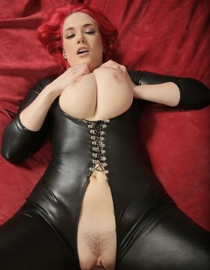 Sexy redhead Siri sucks off a cock in crotchless leather bodysuit