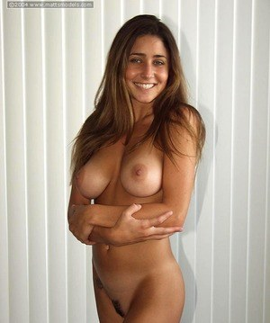 Thin amateur Ashton touts her big natural tits while modeling without clothes