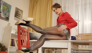 Long legged hot secretary peels down shiny sexy pantyhose to spread pussy lips