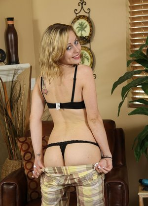 Solo girl Mae Lynn removes long shorts and lingerie before an ass grab