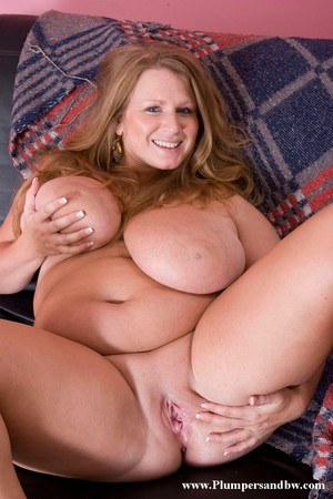 BBW with strawberry blonde hair and giant tits showcases her bald pussy