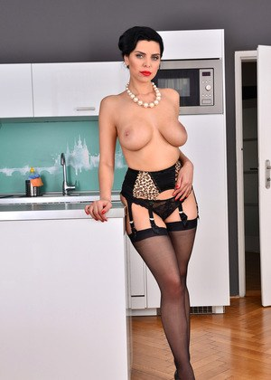 Classy mature female Kira Queen showcases her pussy in the kitchen