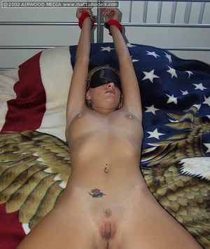 Naked and blindfolded blonde Brandi is restrained to bed spread eagle style