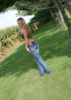 Hot MILF Madden removes her jeans in the backyard to tease in thong panties