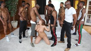 Busty white slut gets gangbanged by a roomful of black guys