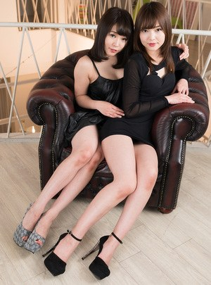 Japanese girls take off heels before giving a double footjob