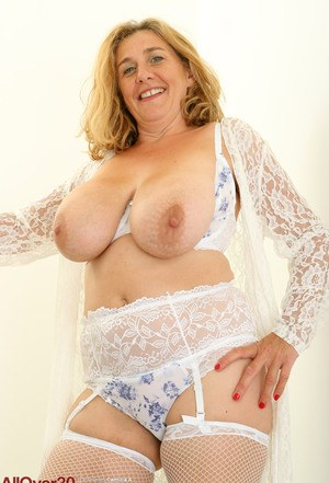 30 plus lady Camilla A fondles her big saggy boobs in mesh stockings
