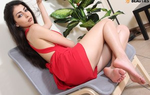 Clothed solo girl with black hair frees her beautiful feet from open toe heels