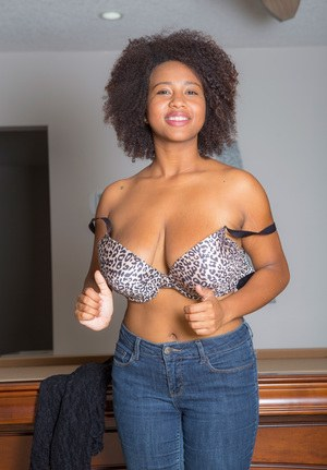 African solo girl Whitney Williams unleashes her large tits as she gets naked