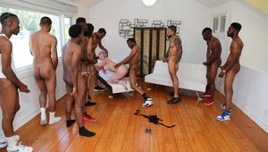 Busty white girl with corn braid hair does a gangbang with black guys