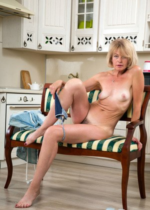 Mature housewife Diana Gold parts her hairy bush after disrobing