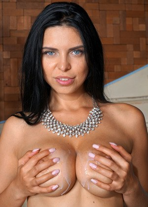 Big boobed brunette Kira Queen licks her guy's dick after riding him in nylons