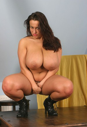 Thick brunette Aneta Buena wraps her massive tits around a post in solo action