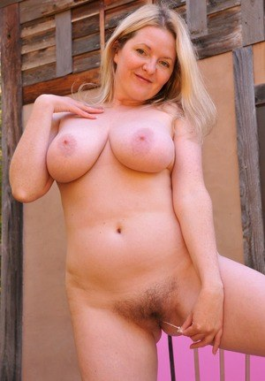 Older woman Tasty Trixie removes her nightgown to pose nude on patio