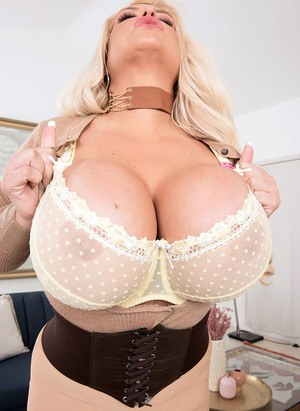 Blonde chick Victoria Vale sets her giant boobs loose in stockings and heels
