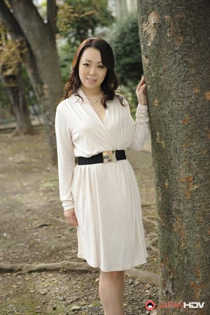 Classy Japanese female Yuna Yamami models non nude outdoors ...