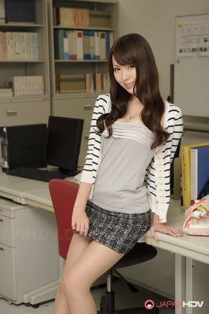 Japanese medical secretary Yui Hatano slowly strips at her workstation