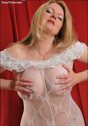 Horny older blonde Tasty Trixie frees her hooters from crotchless bodystocking