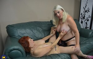 Mature American dykes undress before commencing strapon fucking