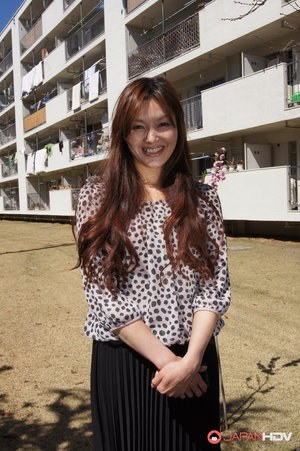 Japanese MILF Hitomi Kano wears a nice smile while modeling non nude