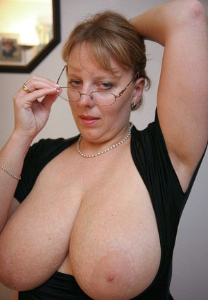 Fat UK lady Curvy Claire sets her huge tits loose in sheer nylons and glasses