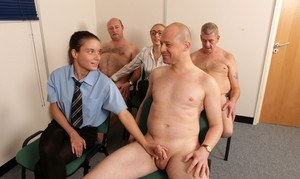Charlie Ten jerks off a naked man after being coached by her female boss