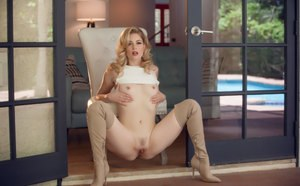 Hot blonde Charlotte Stokely unzips miniskirt to pose nude in thigh high boots