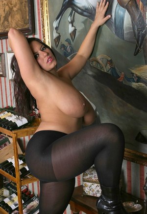 Polish solo girl Aneta Buena unleashes her huge tits in black pantyhose