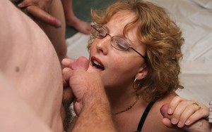 Mature fatty Curvy Claire sucks off cocks in her glasses during a blowbang