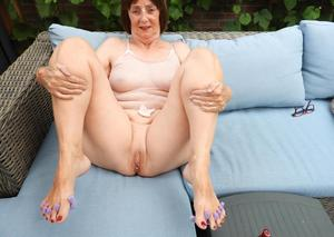 Old woman Kat Kitty gets naked on outdoor sofa while painting her toenails
