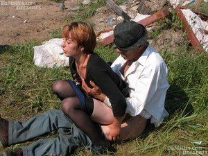 Horny redhead lady finds an old hobo to fuck her horny pussy in a field