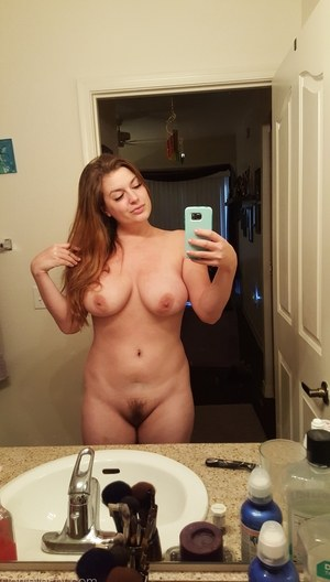 Big titted amateur takes naked selfies of herself indoors and outdoors too